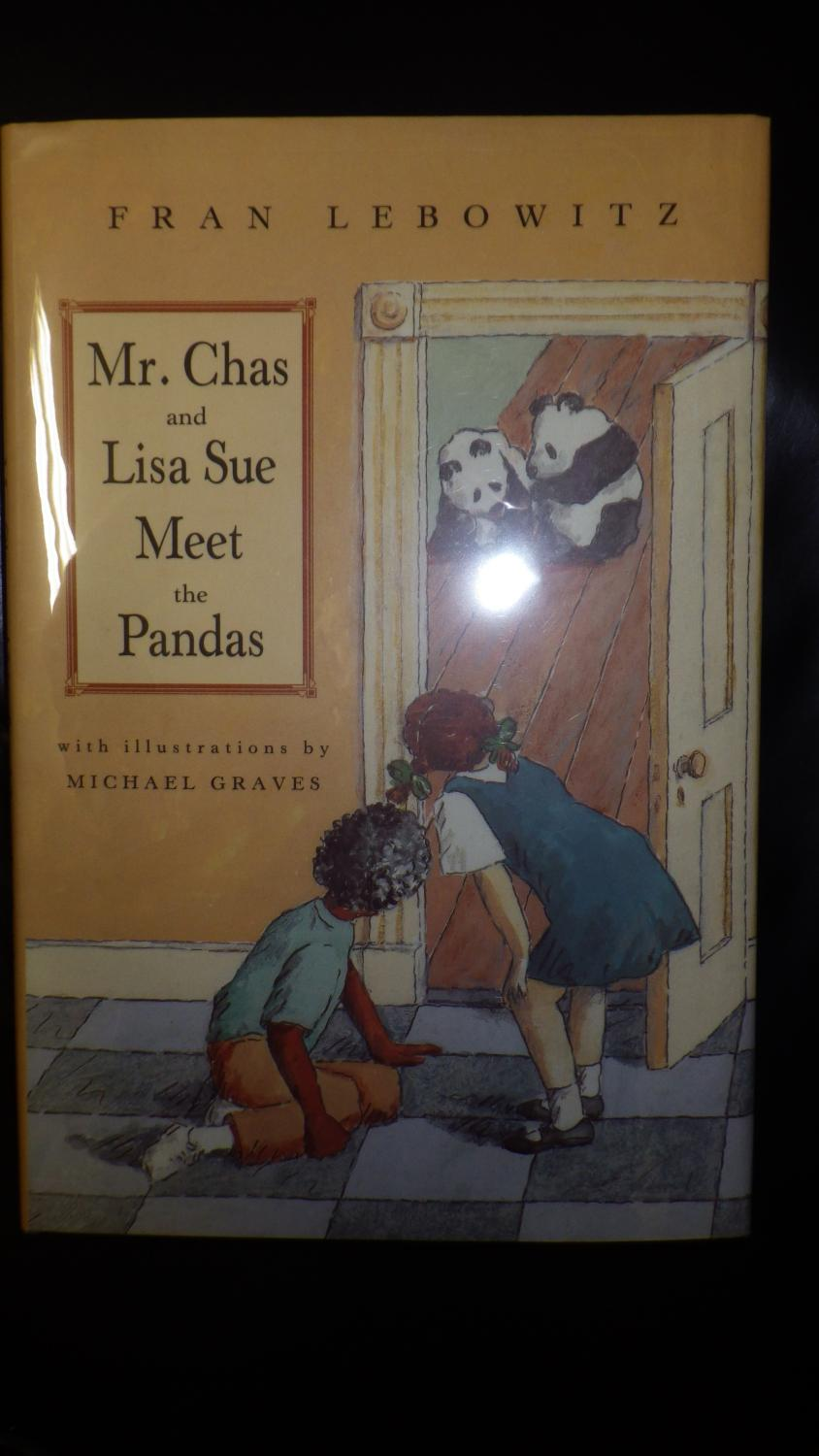 Mr. Chas & Lisa Sue Meet the Pandas, Signed in our presence by Fran Lebowitz , Lebowitz's first (and only) children's book and what a delight it is! While exploring their New York City apartment building, - Fran Lebowitz, B/W illustrated by Michael Graves, SIGNED in our presence by Fran Lebowitz on the title page. Inner DJ Flap has Original Price Intact $15